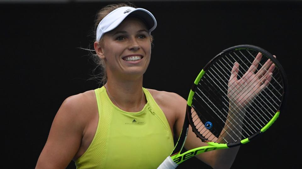 Second seed Wozniacki fights back from the brink