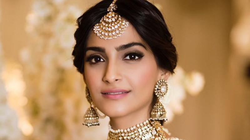 First look: Would-be bride Sonam Kapoor is dolled up in glittery gold at her sangeet
