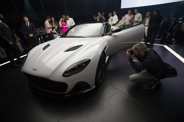 The DBS Superleggera has a bi-turbo, 5.2-liter V12 engine, generating 715 BHP. The car is capable of scorching a highway at 211mph and wouldn't be out of place on a high-fashion runway. Photo: Chris Ratcliffe/Bloomberg