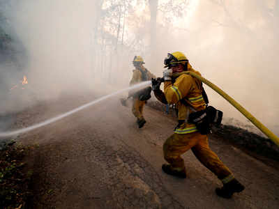 A firefighter knocks down hotspots to slow the spread of the River Fire in Lakeport, California, US. (Reuters file photo)