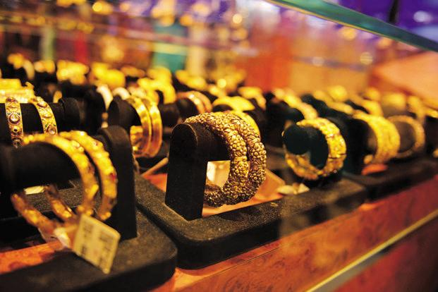 In Delhi, gold prices of 99.9% and 99.5% purity plunged by Rs 290 each to Rs 30,340 and Rs 30,190 per 10 grams, respectively. Photo: Mint