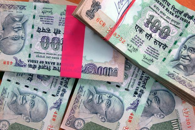 So far this year, the rupee has weakened 8.3%, while foreign investors have sold $383.50 million and $5.40 billion in equity and debt markets, respectively. Photo: Bloomberg