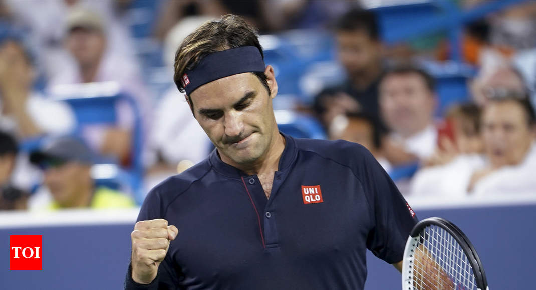 Federer wears down Wawrinka to maintain mastery over compatriot
