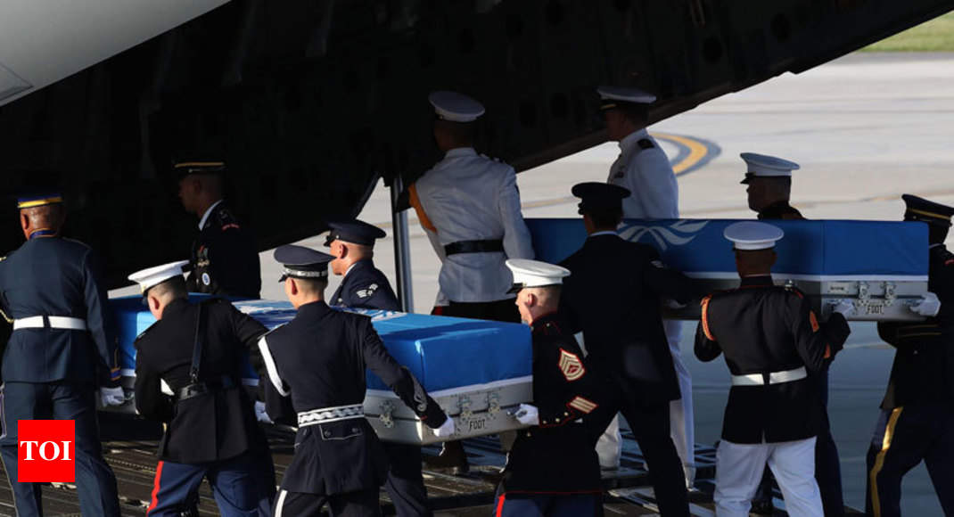 US 'war remains' begin journey home from South Korea