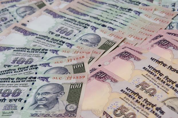 Rupee, bond prices rise after RBI announces dividend payment